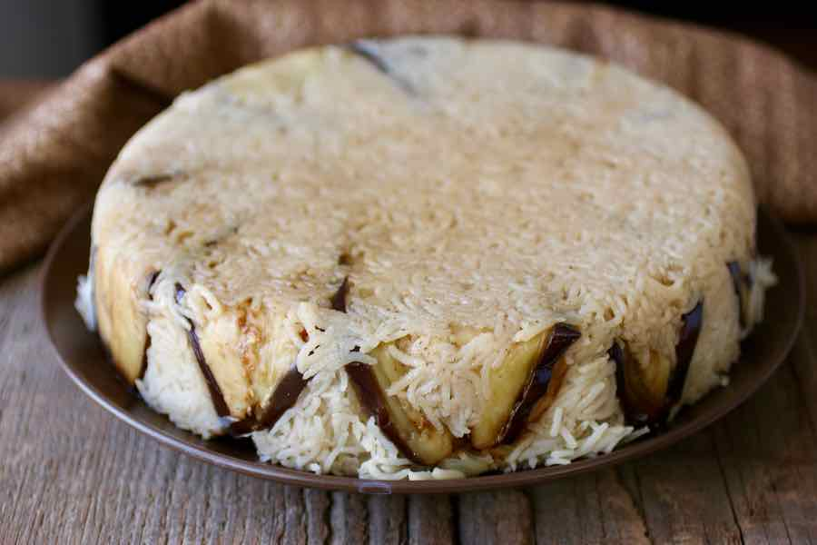 Makluba authentic jordanian recipe 196 flavors the preparation is then turned over to form that very characteristic meat and rice cake in fact the word maqluba in arabic literally means flipped forumfinder Choice Image